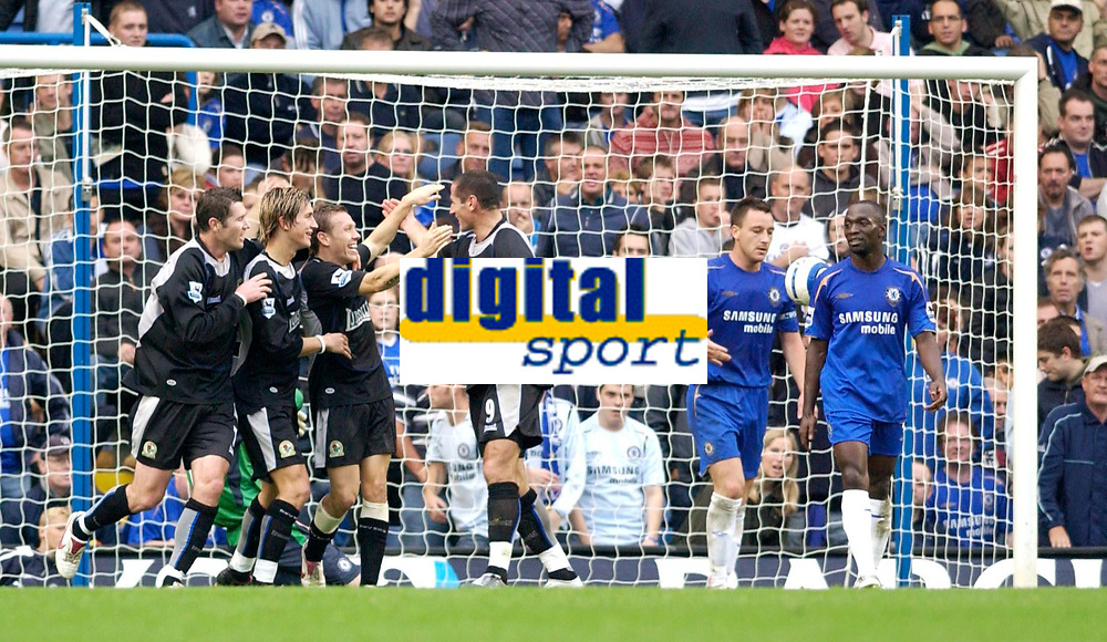 Photo: Daniel Hambury.<br />Chelsea v Blackburn Rovers. The Barclays Premiership.<br />29/10/2005.<br />Blackburn's Craig Bellamy celebrates with team mates after scoring to make the score 2-2 as Chelsea's John Terry and Claude Makelele look on.