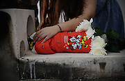 SHANGHAI, CHINA - AUGUST 29: (CHINA OUT) <br /> <br /> The host touches her deceased dog before the cremation during it\'s funeral bought online with 8,000 RMB on August 29, 2015 in Shanghai, China. Miss Wang spent more than 8,000 RMB (about 1,252.8 USD) to buy her deceased dog a funeral on Taobao.com which is China\'s biggest online shop. The dog\'s funeral includes memorial service, cremation and religious rite. The host of the online funeral shop said that they received orders of animal funerals almost everyday.<br /> ©Exclusivepix Media