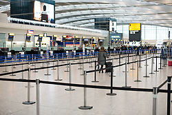 © Licensed to London News Pictures. 23/12/2016. London, UK.  Empty check in isles at Heathrow Airport terminal 5, as the Christmas getaway begins, with stations, airports and roads expected to be very busy as people start their Christmas holidays. Photo credit: Ben Cawthra/LNP