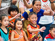 10 JANUARY 2015 - BANGKOK, THAILAND: Thai children react to seeing themselves on television during Children's Day festivities in Bangkok. National Children's Day falls on the second Saturday of the year. Thai government agencies sponsor child friendly events and the military usually opens army bases to children, who come to play on tanks and artillery pieces. This year Thai Prime Minister General Prayuth Chan-ocha, hosted several events at Government House, the Prime Minister's office.    PHOTO BY JACK KURTZ