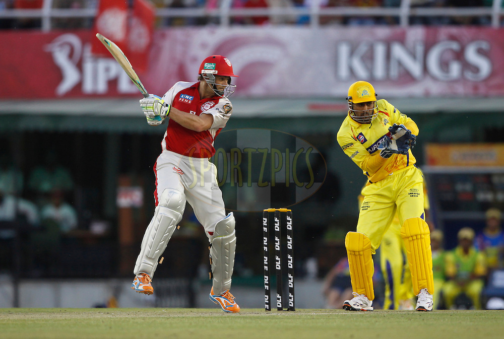 Kings XI Punjab captain Adam Gilchrist  plays a shot  during match 9 of the Indian Premier League ( IPL ) Season 4 between the Kings XI Punjab and the Chennai Super Kings held at the PCA stadium in Mohali, Chandigarh, India on the 13th April 2011..Photo by Pankaj Nangia/BCCI/SPORTZPICS