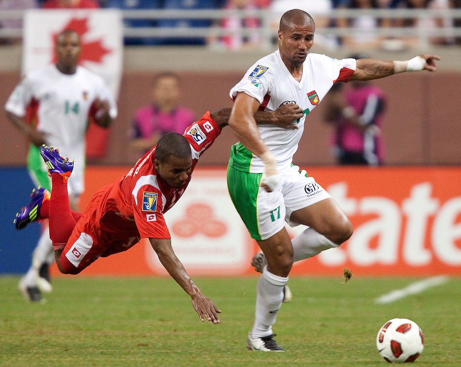Guadeloupe's Cedric Collet evades Panama's Luis Henriquez  during their CONCACAF match at Ford Field in Detroit Michigan, June 7, 2011.<br /> AFP PHOTO/Geoff Robins