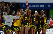 Jamaica players celebrate defeating England in the Bronze medal playoff match. Glasgow Commonwealth Games at the SSE Hydro Glasgow, Scotland. Sunday 3 August 2014. Photo: Andrew Cornaga/www.Photosport.co.nz