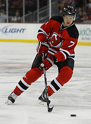 Mar 20, 2009; Newark, NJ, USA; New Jersey Devils defenseman Paul Martin (7) skates with the puck during the first period of their game against the Minnesota Wild at the Prudential Center.