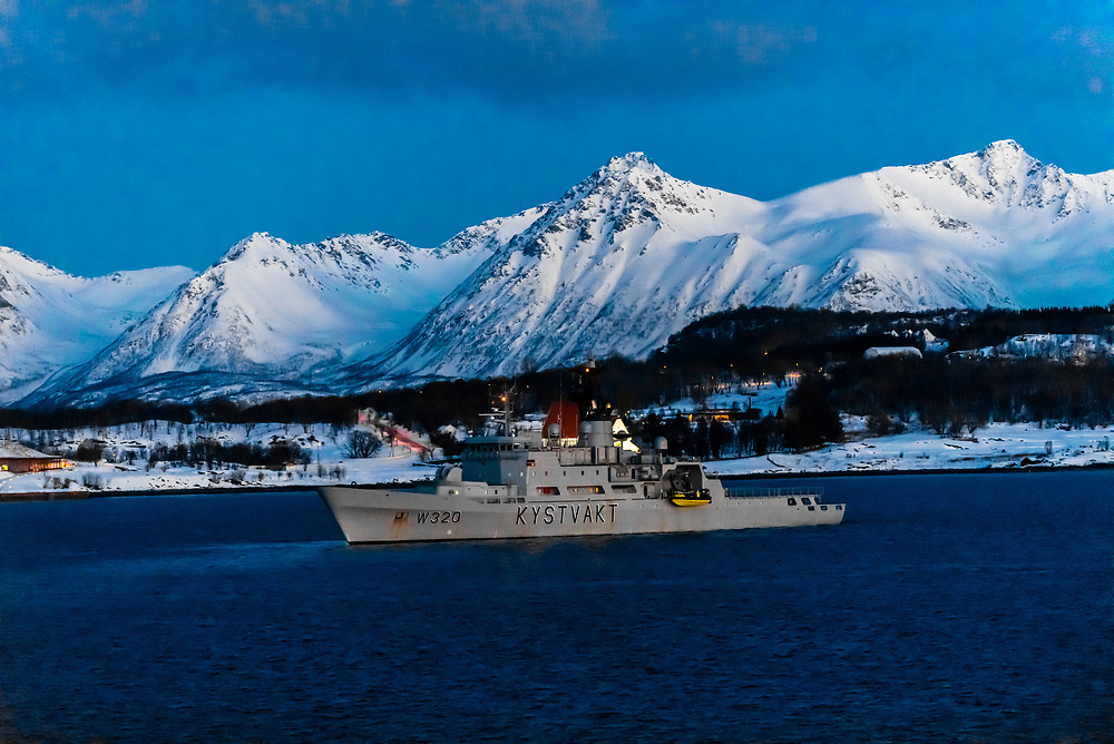 Kystvakt, a Nordkapp class Norwegian Coast Guard ship off the coastline near Harstad, Arctic, Northern Norway.