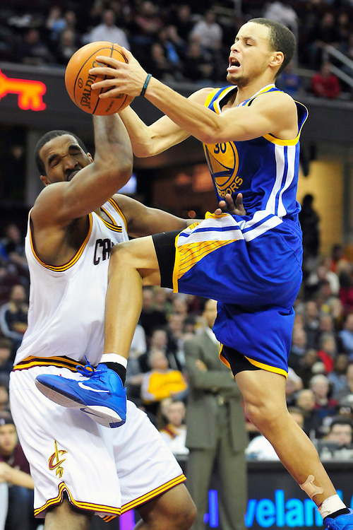 March 8, 2011; Cleveland, OH, USA; Golden State Warriors point guard Stephen Curry (30) tries to shoot over Cleveland Cavaliers power forward Samardo Samuels (24) during the fourth quarter at Quicken Loans Arena. The Warriors beat the Cavaliers 95-85. Mandatory Credit: Jason Miller-US PRESSWIRE