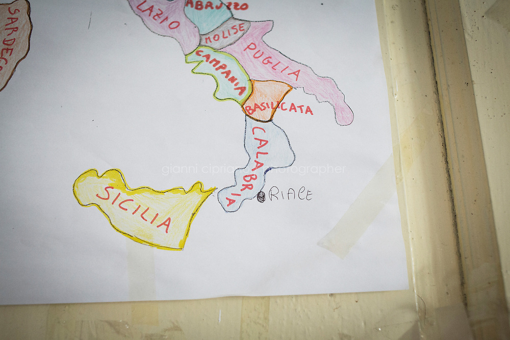 RIACE, ITALY - 24 October 2013: The town of Riace is spotted on a map of Italy hanging on a wall of Palazzo Pinnarò, headquarters of the association Città Futura (Future City) in Riace, Italy, on October 24th 2013.