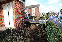 © London News Pictures. 15/02/2014. Hemel Hempstead, UK.  A giant sinkhole (pictured centre) measuring 35ft wide by 20ft deep has opened up next to a house in Hemel Hempstead, Hertfordshire.  Photo credit: Ben Cawthra/LNP