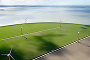 Nederland, Flevoland, Almere, 07-05-2015;  Almere-Pampus, Pampus Poort met windmolenpark grenzend aan het IJmeer. Skyline Amsterdam met IJburg aan de horizon.<br /> Windfarm near Almere, skyline Amsterdam at the horizon.<br /> luchtfoto (toeslag op standard tarieven);<br /> aerial photo (additional fee required);<br /> copyright foto/photo Siebe Swart