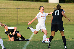 Virginia Cavaliers midfielder/forward Caitlin Miskel (7) beats VCU Rams defender/midfielder Michelle Schuler (3) to the ball and gets a shot off inside the 18 yard line.  The Virginia Cavaliers defeated the VCU Rams 5-0 in women's soccer at Klockner Stadium on the Grounds of the University of Virginia in Charlottesville, VA on August 31, 2008.