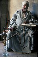 man smoking a water pipe, El Fayoum, Egypt