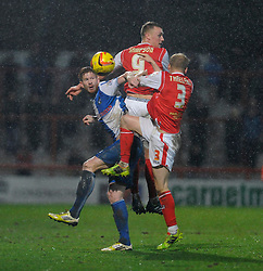 Bristol Rovers' Matt Harrold challenges Morecambe's Robbie Threlfall and Morecambe's Jack Sampson to the header - Photo mandatory by-line: Dougie Allward/JMP - Tel: Mobile: 07966 386802 14/12/2013 - SPORT - Football - Morecombe - Globe Arena - Morecombe v Bristol Rovers - Sky Bet League Two