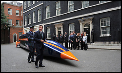 The PM with Wing Commander Andy Green as they look around The British Bloodhound Super Sonic Car<br /> 10 Downing Street, London, United Kingdom. As the Prime Minister to announces initiative to create 100,000 Engineering Technicians.<br /> Monday, 24th June 2013<br /> Picture by Andrew Parsons / i-Images