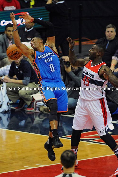 10 November 2015:  Oklahoma City Thunder guard Russell Westbrook (0) is fouled by Washington Wizards center DeJuan Blair (45) at the Verizon Center in Washington, D.C. where the Oklahoma City Thunder defeated the Washington Wizards, 125-101. (Photograph by Icon Sportswire)