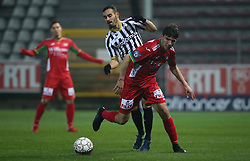 December 1, 2017 - Charleroi, BELGIUM - Charleroi's Stergos Marinos and Oostende's Aleksandar Bjelica fight for the ball during the Jupiler Pro League match between Sporting Charleroi and KV Oostende, in Charleroi, Friday 01 December 2017, on the day 17 of the Jupiler Pro League, the Belgian soccer championship season 2017-2018. BELGA PHOTO VIRGINIE LEFOUR (Credit Image: © Virginie Lefour/Belga via ZUMA Press)