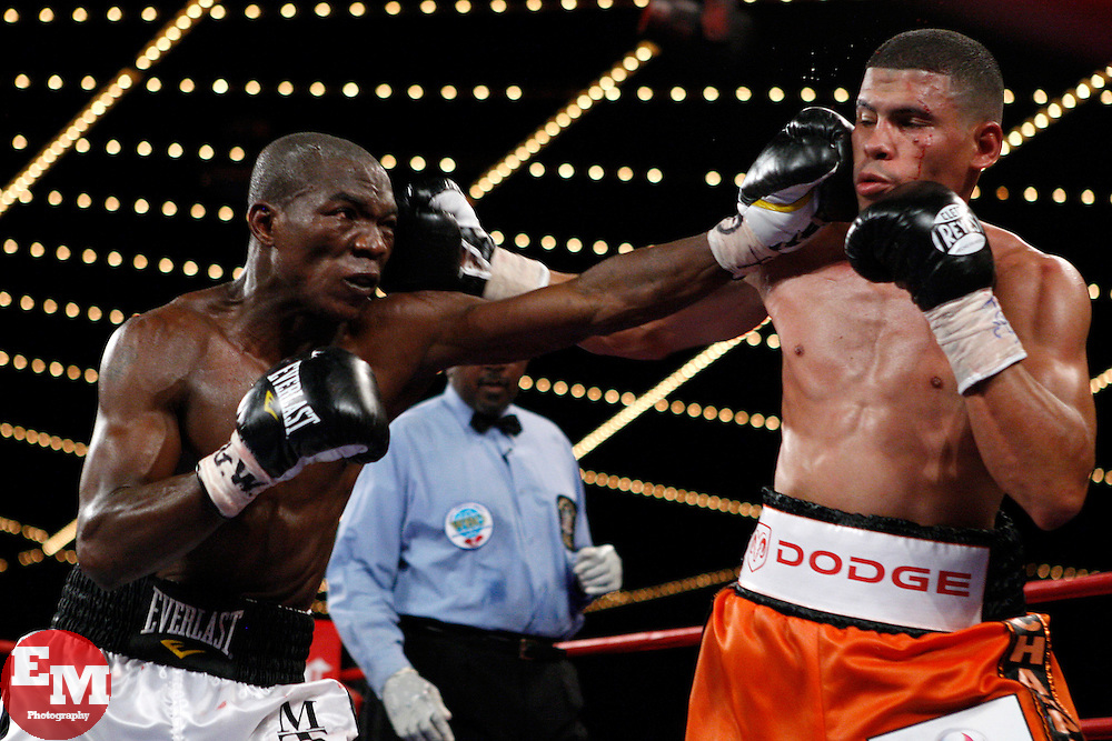 October 10, 2009; New York, NY; USA;  Juan Manuel Lopez and Rogers Mtagwa trade punches during their WBO Jr. Featherweight Championship bout at the WaMu Theatre at Madison Square Garden in New York, NY.  Mandatory Credit:  Ed Mulholland