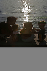 Family at lake. (Photo by Vid Ponikvar / Sportal Images)