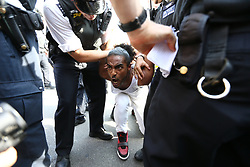 © Licensed to London News Pictures. 21/06/2017. London, UK. A man is arrested as a protest takes place Outside the house of commons that is aiming to bring down the Government. The Demonstration by Movement for Justice By Any Means Necessary is billed as a day of action for the victims of the Grenfell Tower disaster. Photo credit: Andrew McCaren/LNP