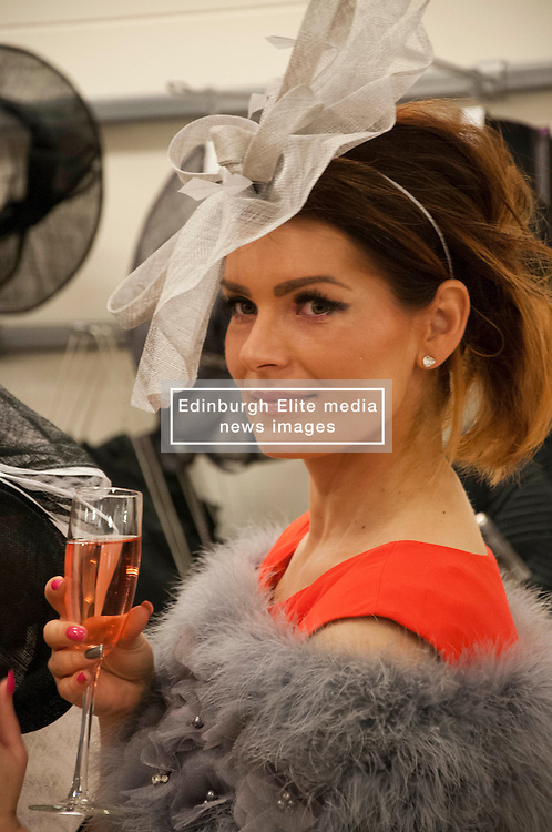 Kate Podles joins the ladiesas they line up at Allure Medi Spain Debenhams at Ocean Terminal to get ready for Ladies Day at Musselburgh Race Course. 11 June 2012 (Ger Harley | StockPix).
