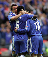 Photo: Paul Thomas.<br /> Chelsea v Manchester United. The FA Cup Final. 19/05/2007.<br /> <br /> John Terry of Chelsea celebrates with Michael Essien and Wayne Bridge.