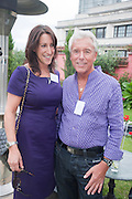 JULIET GORDON; LES BARRETT, Archant Summer party. Kensington Roof Gardens. London. 7 July 2010. -DO NOT ARCHIVE-© Copyright Photograph by Dafydd Jones. 248 Clapham Rd. London SW9 0PZ. Tel 0207 820 0771. www.dafjones.com.