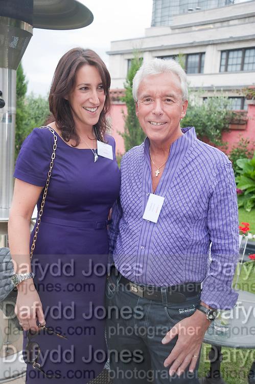 JULIET GORDON; LES BARRETT, Archant Summer party. Kensington Roof Gardens. London. 7 July 2010. -DO NOT ARCHIVE-© Copyright Photograph by Dafydd Jones. 248 Clapham Rd. London SW9 0PZ. Tel 0207 820 0771. www.dafjones.com.