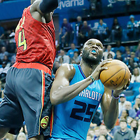 01 November 2015: Atlanta Hawks forward Paul Millsap (4) defends on Charlotte Hornets center Al Jefferson (25) during the Atlanta Hawks 94-92 victory over the Charlotte Hornets, at the Time Warner Cable Arena, in Charlotte, North Carolina, USA.