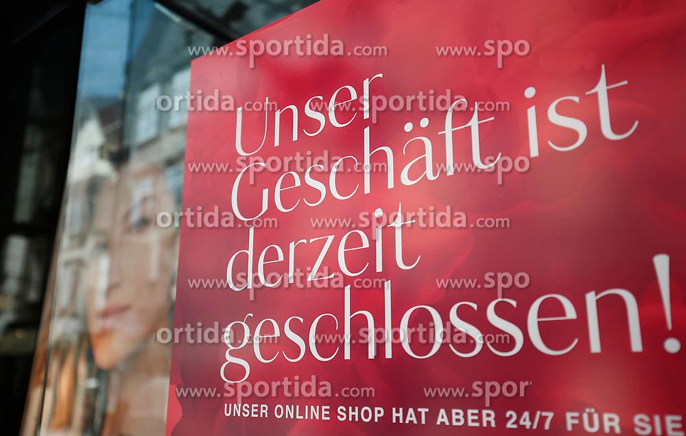"""THEMENBILD - Ein Hinweisschild an einem Geschäft in Graz in Folge des Coronavirus-Ausbruchs in Österreich, aufgenommen am 16.03.2020 in Graz, Österreich // A sign saying """"We're closed"""" on a store as a result of the coronavirus outbreak in Austria, on 2020/03/16 in Graz, Austria. EXPA Pictures © 2020, PhotoCredit: EXPA/ Erwin Scheriau"""