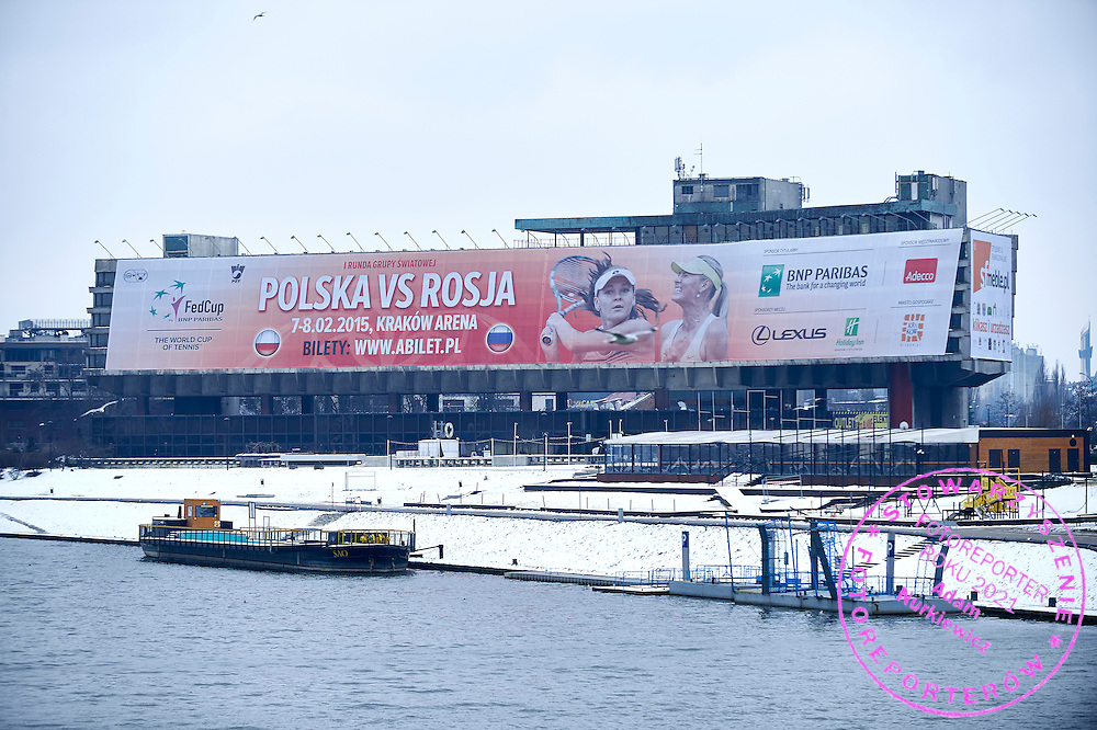 Big advertise billboard of Fed Cup match on the building in Cracow city centre during official draw one day before the Fed Cup / World Group 1st round tennis match between Poland and Russia at Holiday Inn on February 6, 2015 in Cracow, Poland.<br /> <br /> Poland, Cracow, February 6, 2015<br /> <br /> Picture also available in RAW (NEF) or TIFF format on special request.<br /> <br /> For editorial use only. Any commercial or promotional use requires permission.<br /> <br /> Adam Nurkiewicz declares that he has no rights to the image of people at the photographs of his authorship.<br /> <br /> Mandatory credit:<br /> Photo by &copy; Adam Nurkiewicz / Mediasport
