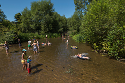 © Licensed to London News Pictures. 07/08/2020. CHORLEYWOOD, UK. People enjoy the cool waters of the River Chess near Chorleywood, Hertfordshire.  The forecast is for temperatures to continue to exceed 30C for the next few days.  Photo credit: Stephen Chung/LNP
