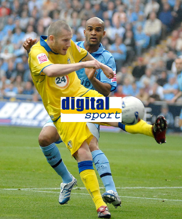 Photo: Ed Godden.<br />Coventry City v Leeds United. Coca Cola Championship. 16/09/2006. Leeds' Kevin Nicholls (L) clears the ball from the oncoming Leon McKenzie.