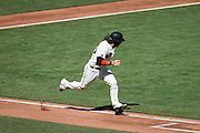 San Francisco Giants left fielder Angel Pagan (16) runs to first base after making contact with a pitch against the Los Angeles Dodgers at AT&T Park in San Francisco, Calif., on October 1, 2016. (Stan Olszewski/Special to S.F. Examiner)