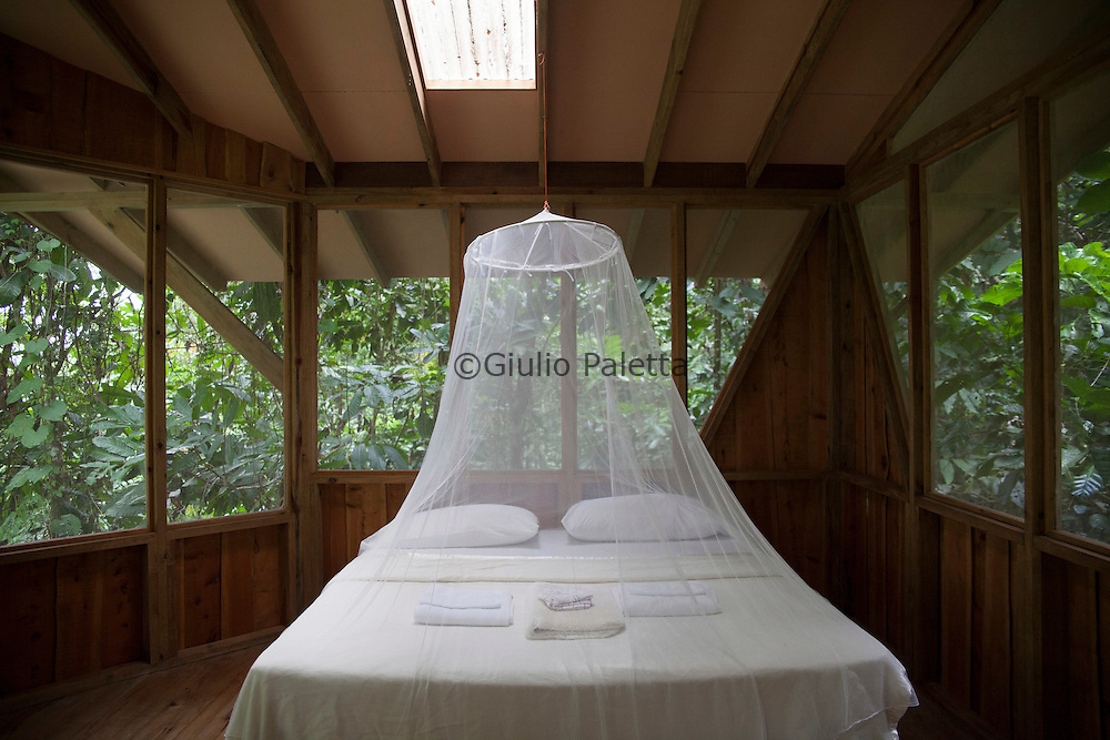 Bedroom of one of the tree houses of Finca Bellavista