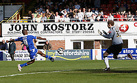 Photo: Steve Bond/Richard Lane Photography. Hereford United v Leicester City. Coca Cola League One. 11/04/2009. Lloyd Dyer (L) connects with the ball to score past keeper Peter Gulacsi