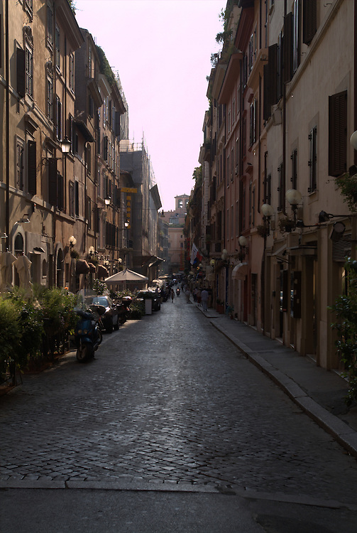 City street with tourists in Rome, Italy