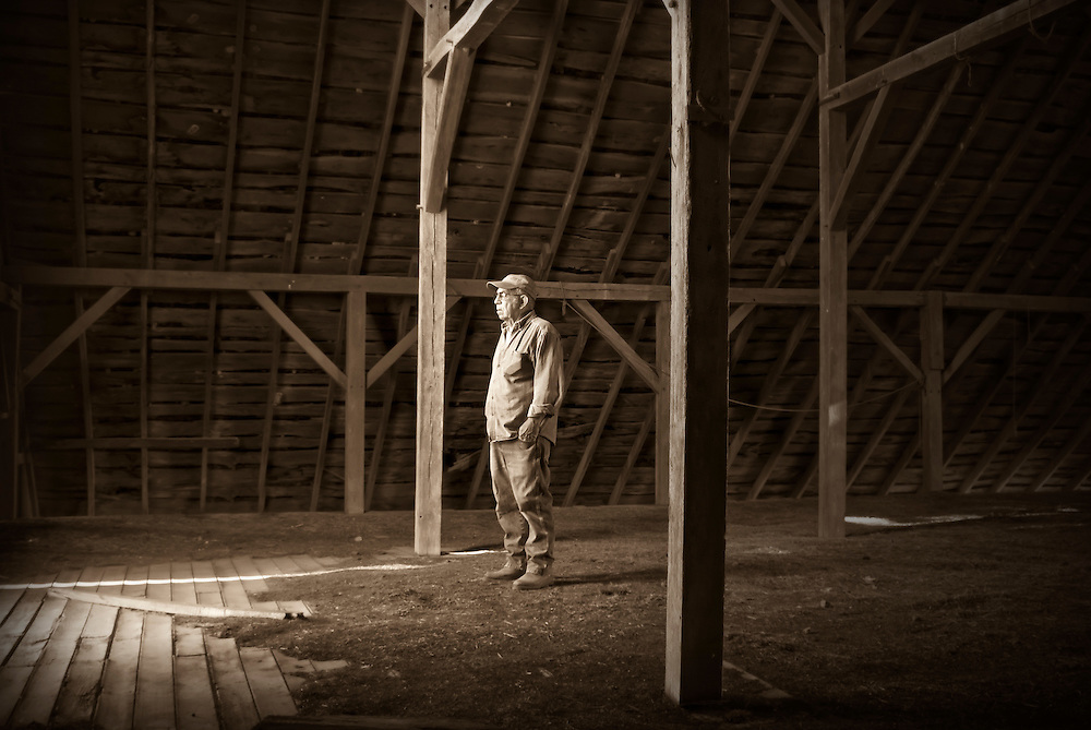 Ron Snyder contemplating the morning in Barker's barn, Mt Vernon, Missouri