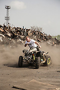 Dinko Valev rides his ATV 4x4 around his junkyard in Yambol, Bulgaria. <br /> <br /> Matt Lutton / Boreal Collective for VICE