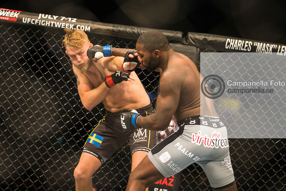 STOCKHOLM, SWEDEN - JANUARY 24: Anthony Johnson of the United States lands a punch on Alexander Gustafsson of Sweden during the UFC Fight Night event at Tele2 Arena on January 24, 2015 in Stockholm, Sweden. (Photo by Michael Campanella/Zuffa LLC/Zuffa LLC via Getty Images)