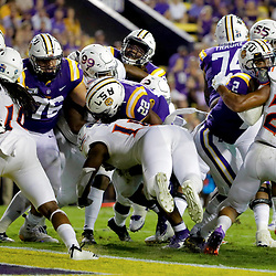 Sep 14, 2019; Baton Rouge, LA, USA; LSU Tigers running back Clyde Edwards-Helaire (22) scores past Northwestern State Demons linebacker Jomard Valsin Jr. (11) during the second quarter at Tiger Stadium. Mandatory Credit: Derick E. Hingle-USA TODAY Sports