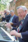"""DADDY SELLS IT--""""Daddy"""" Herb Sell gets in a musical groove as he and his combo entertain the crowd at the Flower and Jazz Market."""