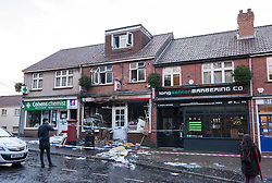 © Licensed to London News Pictures. 04/01/2016. Long Ashton, North Somerset, UK. A cashpoint and the front of the Post Office in Long Ashton near Bristol has been destroyed in what is thought to have been a robbery using gas to blow up the cashpoint which happened about 3.30am today.  Cash has been taken and three people have been arrested and are being held on suspicion of causing an explosion with intent to endanger life. There have been several other similar attacks on cashpoints in the Bristol area in the last year or two. Photo credit : Simon Chapman/LNP