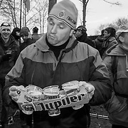 A precarious situation for a spectator and his beer. The Jupiler brand, the top-selling beer in Belgium, is part of the massive InBev conglomerate, which reports having sold more than thirty thousand liters of beer at the 2012 World Championships.