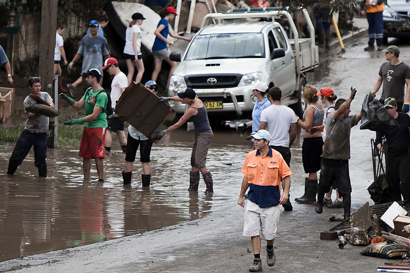 Volunteers and their tools of trade clean up the suburban streets in the wake of the 2011 Brisbane River Flood
