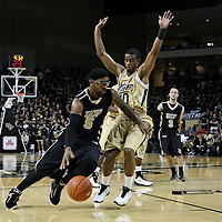 Central Florida guard Marcus Jordan (5)  drives past Anthony Crater (10) during the NCAA basketball game against the USF Bulls at the UCF Arena on November 18, 2010 in Orlando, Florida. UCF won the game 65-59. (AP Photo/Alex Menendez)