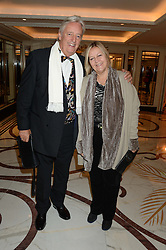 MICHAEL MANSFIELD QC and his wife YVETTE VANSON at the inaugural Stephen Lawrence Memorial Ball held at The Dorchester, Park Lane, London on 17th October 2013.