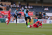 Russell Penn tackles Sam Wood during the Sky Bet League 2 match between Wycombe Wanderers and York City at Adams Park, High Wycombe, England on 8 August 2015. Photo by Simon Davies.