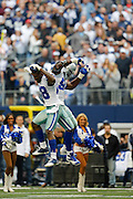 Dallas Cowboys wide receiver Dez Bryant (88) and tight end James Hanna (84) bump in the air before hosting the New Orleans Saints at Cowboys Stadium in Arlington, Texas, on December 23, 2012.  (Stan Olszewski/The Dallas Morning News)
