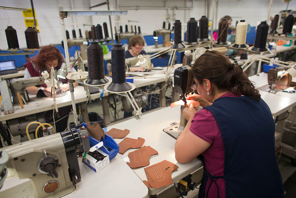 A sewer starts the process of stitching the various pieces of leather in the hand made shoe process at Allen Edmunds shoe Company sit on a shelf at the companies headquarters in Port Washington, Wisconsin April 12, 2011.  Darren Hauck
