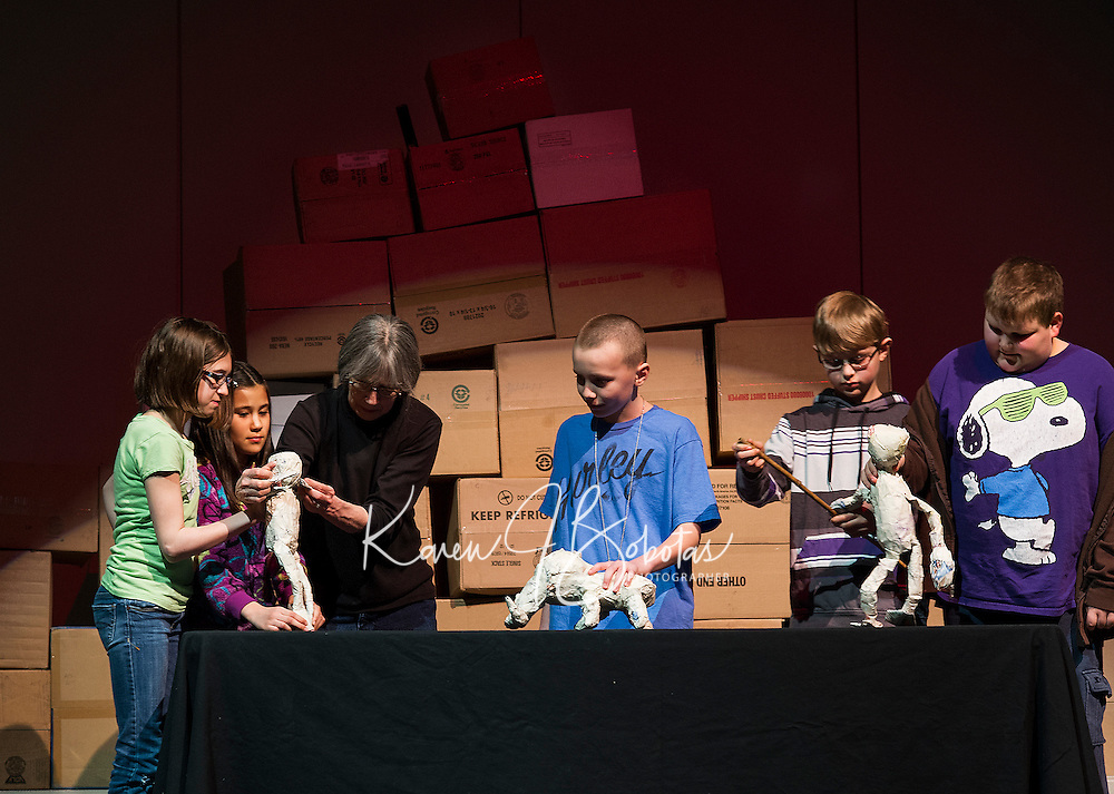 """Madeline Tredo, Jade Pickowicz, Artist in Residence Bonnie Periale, Brian Tremblay, Mathieu Sherburn and Joe Laurendeau depict life in Pompeii during their puppet performance of """"Scenes from Ancient Pompeii"""" at Gilmanton Elementary School Wednesday afternoon.   (Karen Bobotas/for the Laconia Daily Sun)"""