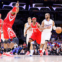 14 May 2015: Los Angeles Clippers guard Chris Paul (3) drives past Houston Rockets guard Jason Terry (31) and faces Houston Rockets center Dwight Howard (12) during the Houston Rockets 119-107 victory over the Los Angeles Clippers, in game 6 of the Western Conference semifinals, at the Staples Center, Los Angeles, California, USA.